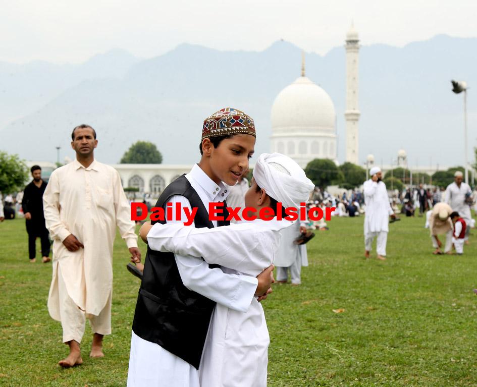 Children hugging each other after Eid prayers at Hazrat bal  Srinagar.Excelsior/Shakeel