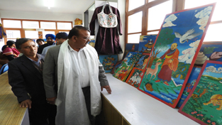 Industries Minister Chander Parkash Ganga during visit to Arts Emporium at Leh on Friday.