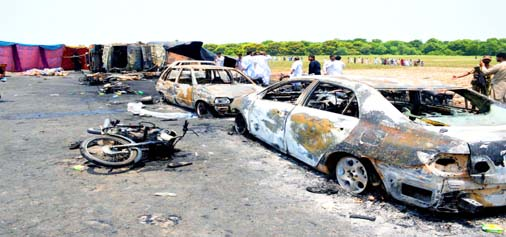 Burnt out cars and motorcycles are seen at the scene of an oil tanker explosion in Bahawalpur, Pakistan on Sunday.