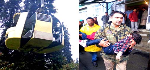 Tourists trapped in Gondola (left) and a police officer shifts the victim to hospital at Gulmarg on Sunday.