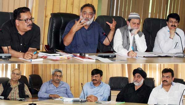 Minister for Finance, Dr Haseeb Drabu chairing a meeting at Srinagar on Monday.