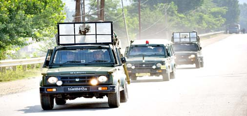 Army vehicles moving towards the site of an encounter at Pantha Chowk, Srinagar on Sunday.-Excelsior/Shakeel
