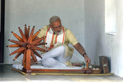 Prime Minister Narendra Modi spinning a charkah during his visit at Sabarmati Ashram in Ahmedabad on Thursday. (UNI)