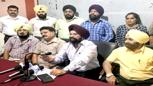 Hockey enthusiasts Romal Singh, MS Reen and others addressing media persons in Jammu on Thursday.-Excelsior/Rakesh