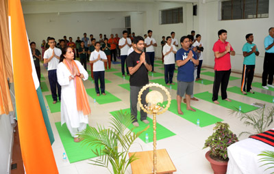 Participants including Director IIM Sirmaur Dr Neelu Rohmetra performing a Yog Asan.
