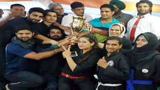 Triumphant J&K Thang-Ta team holding runners-up trophy while posing for a group photograph at Agra in Uttar Pradesh.