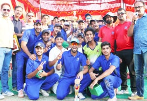 Jubilant KCCC players posing for a group photograph along with chief guest after lifting Simula T20 Super League title.