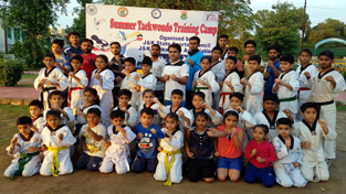 Participants of Taekwando Talent Hunt Training Camp posing for a group photograph alongwith officials during inaugural function. Young sportspersons will be imparted training by Atul Pangotra, Taekwando coach of J&K State Sports Council. Also seen in the picture is organising secretary, Anuj Sharma.