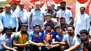 Jubilant players of RS Pura Cricket Club posing for a group photograph after winning Sumer Cup cricket title on Friday.