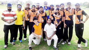 Players of Patel Cricket Club posing for a group photograph after defeating Provin Cricket Club in Jammu on Sunday.