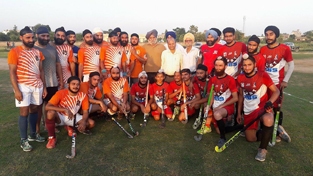 Winners of exhibition hockey match posing for a group photograph alongwith officials in Jammu on Friday.