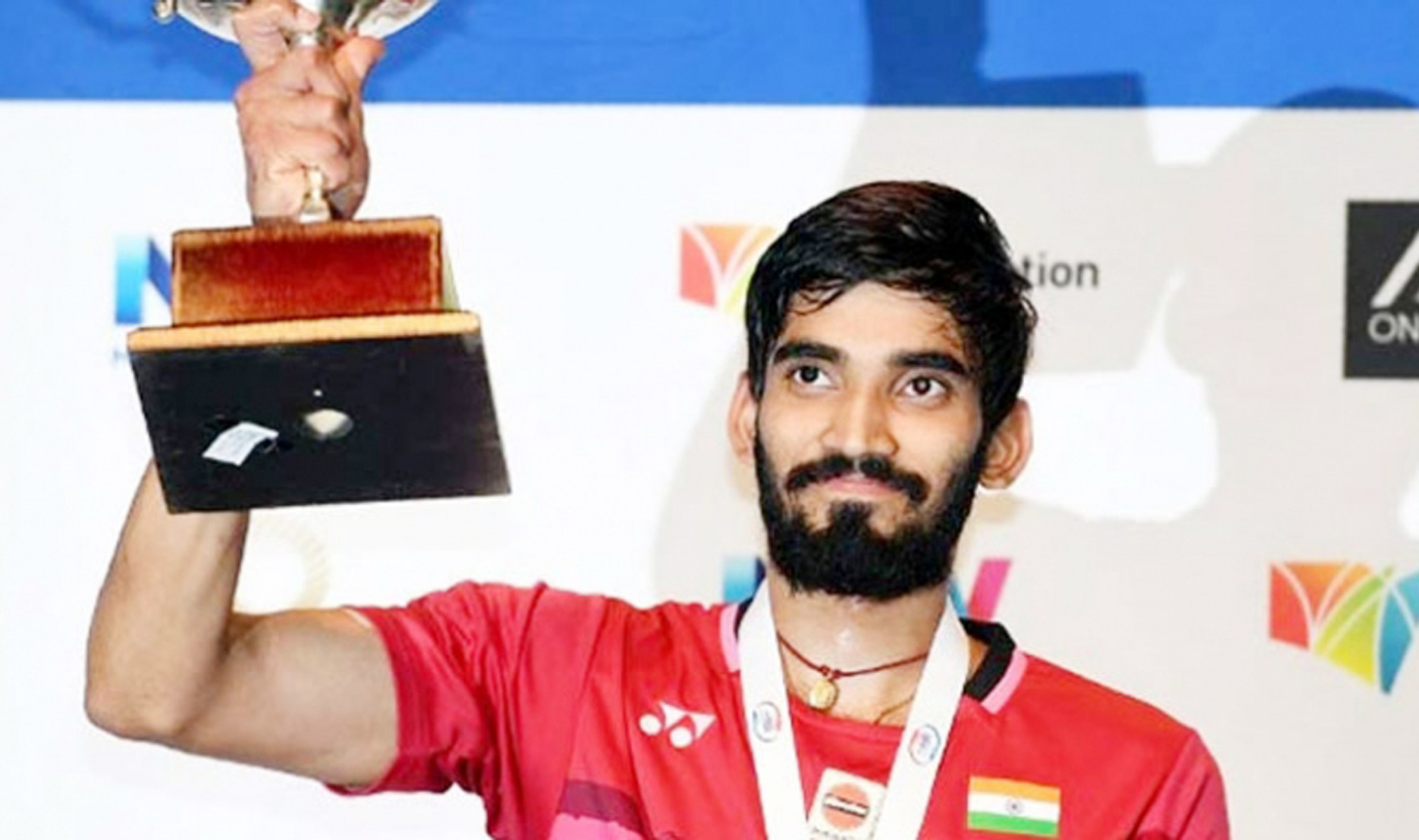 Srikanth holding trophy after claiming Australian Open SS tital in Sydney.