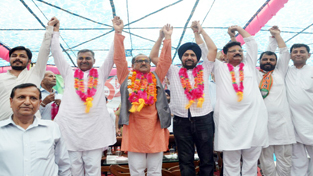Deputy Chief Minister, Dr Nirmal Singh and other BJP leaders during a rally at Billawar on Tuesday. -Excelsior/ Madan