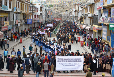 Civil society taking out massive protest rally at Leh on Thursday. -Excelsior/ Morup Stanzin