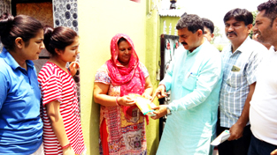 MP Jugal Kishore Sharma during door to door campaign in R S Pura on Sunday.