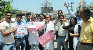 Youth Congress activists staging protest in front of train at Jammu on Thursday. -Excelsior/Rakesh