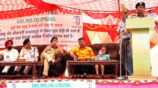 SSP Jammu, Dr Sunil Gupta addressing a seminar organised by Team Jammu at RS Pura on Sunday.
