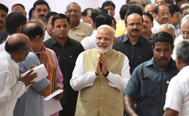 Modi walks up to opposition leaders