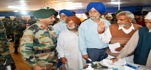 GOC Victor Force B S Raju at Mega Mela organised by 1 RR under the aegis of 1 Sector in Anantnag on Wednesday.-Excelsior/Sajad Dar