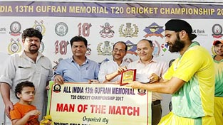 Kulwinder receiving Man of the Match award at Sports Stadium in Doda.
