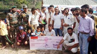 Winners of Drangbal Premier League posing for a group photograph at Drangbal in Baramulla on Sunday.