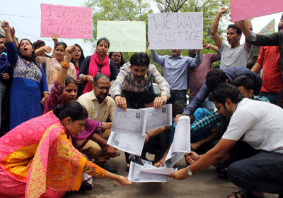 Agitating Polytechnic academic arrangements staff torching their degrees during protest on Friday.