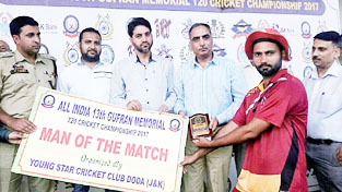 Man of the match award being presented to the winner by the dignitaries at Sports Stadium in Doda.