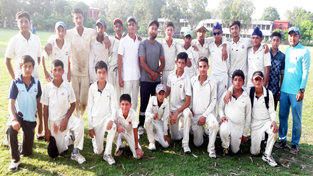 KCCC Juniors and MIER Academy U-15 cricket teams posing for a group photograph at GGM Science College Hostel ground in Jammu.