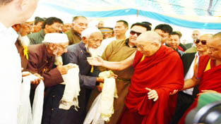 Spiritual leader Dalai Lama being greeted by Muslim community during his visit to Eidgah, Leh.—Excelsior/Morup Stanzin