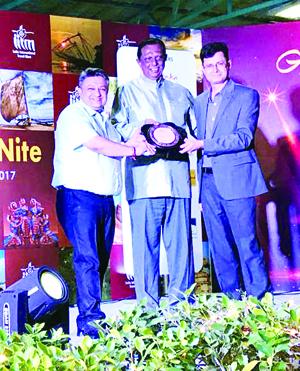 Director Tourism Kashmir, Mahmood A Shah receiving award at IITM Banglore on Sunday.