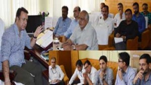 Minister for FCS&CA Ch Zulfkar Ali chairing a meeting at Srinagar on Thursday.