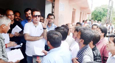 Minister for FCS&CA, Ch. Zulfkar Ali interacting with people at Jagti on Monday.