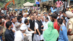 NC Provincial President Devender Singh Rana and others visiting families of victims of Thathri mishap on Saturday.