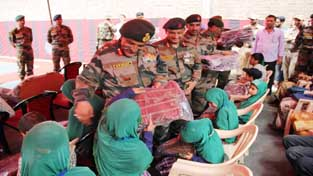 GOC, Dagger Division, Major General, R P Kalita, providing aid to students of Blind School Baramulla.