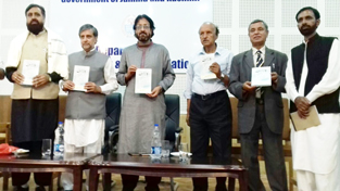 Former minister and NC MLA, Mian Altaf and others releasing book in Gojri at a function in Srinagar.