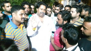 Cong leader Raman Bhalla interacting with public on Thursday.