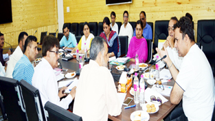 Minister for Information, Ch Zulfkar Ali chairing a meeting at Srinagar on Wednesday.