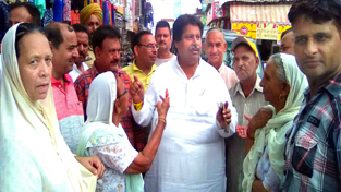 Senior PCC leader Raman Bhalla interacting with people from Nai Basti on Wednesday.