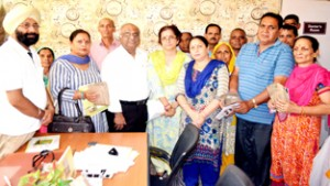 Beneficiaries of the BMD camp held at ESI Dispensary, Talab Tillo, Jammu on Thursday.