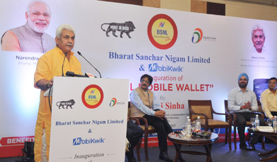 """Minister of State for Communications (Independent Charge) and Railways, Manoj Sinha addressing at the launch of the """"BSNL-Mobikwik Payment App"""", in New Delhi on Friday."""