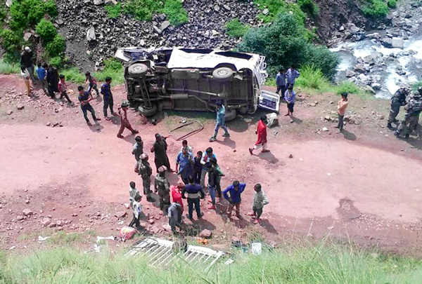Locals and police rescuing victims at accident site in Mahore on Wednesday.