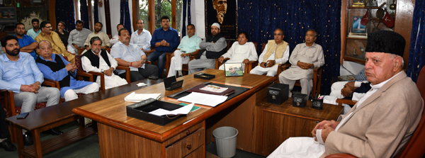 NC president Dr Farooq Abdullah presiding over an Opposition meeting in Srinagar on Friday.
