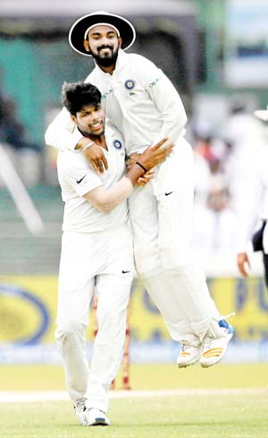 India's Umesh Yadav celebrates with his teammate Lokesh Rahul after taking the wicket of Sri Lanka's Upul Tharanga in Colombo on Saturday.