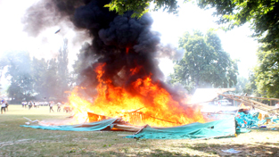Stage and tents set afire by the students at GDC Anantnag on Wednesday.     -Excelsior/Younis Khaliq