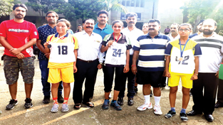 Winners of Inter-Collegiate Cross Country (Women) posing for a photograph along with dignitaries in Jammu.