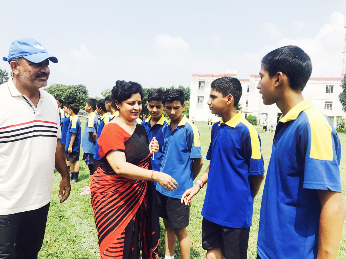 Vandana Sharma, Headmistress DPS Katra and Dr SS Chib, DYSSO Reasi interacting with footballers in Reasi on Tuesday.