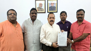 Union Minister Dr Jitendra Singh receiving a memorandum from a delegation of All India General Insurance Agents Federation Integrated (Regd) at New Delhi on Monday.