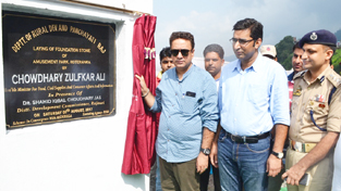 Minister for FCS &CA, Zulfkar Ali laying foundation stone of amusement park at Kotranka in Rajouri on Saturday.