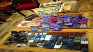 Cell phones and incriminating material recovered from Baramulla jail inmates.