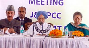 Former PM Dr Manmohan Singh addressing PCC meeting in Srinagar on Saturday. -Excelsior/Shakeel